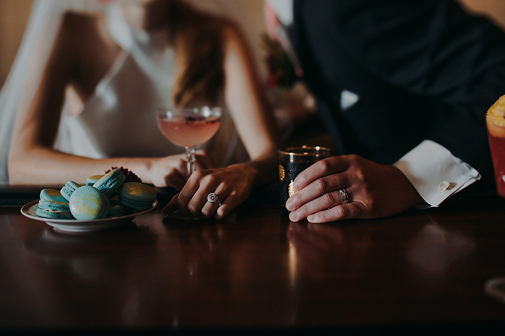 bride and groom holding signature cocktails in a downtown Milwaukee wedding