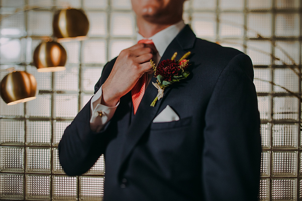mid century modern groom in a Milwaukee, Wisconsin wedding