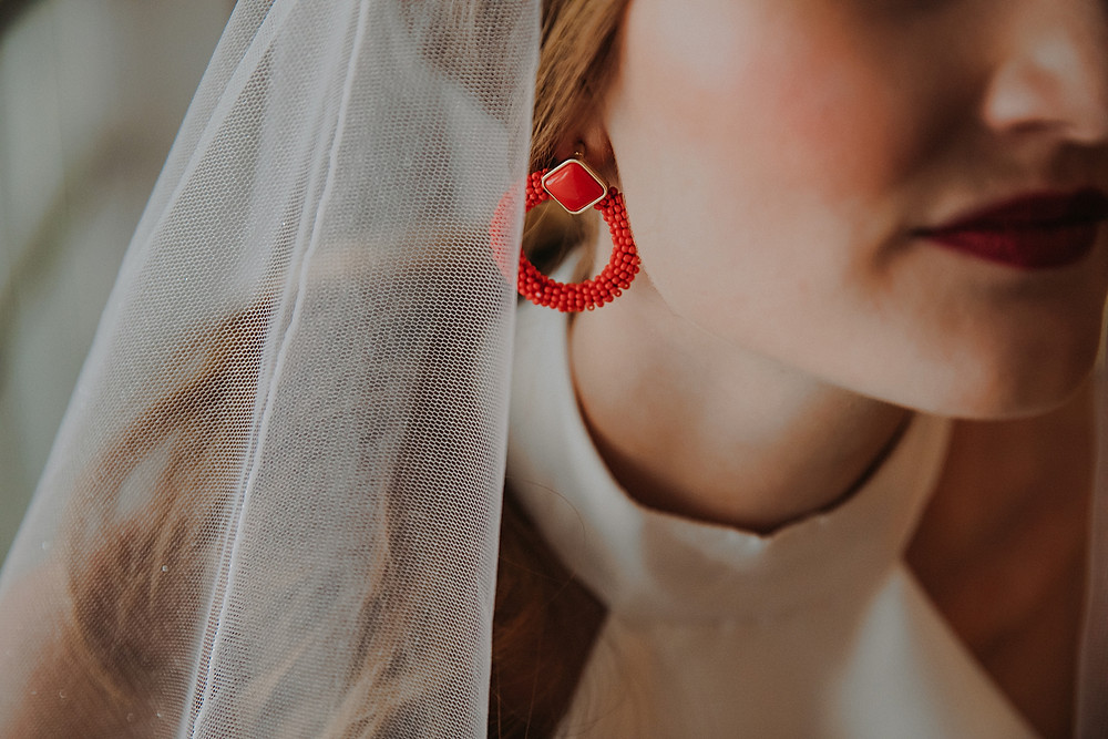 chunky red hoop earrings at a mid-century modern Wisconsin wedding