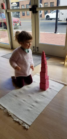 Admiring the Pink Tower