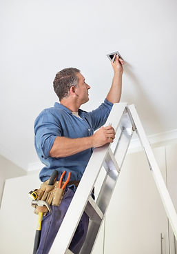 Electrician working on a ladder