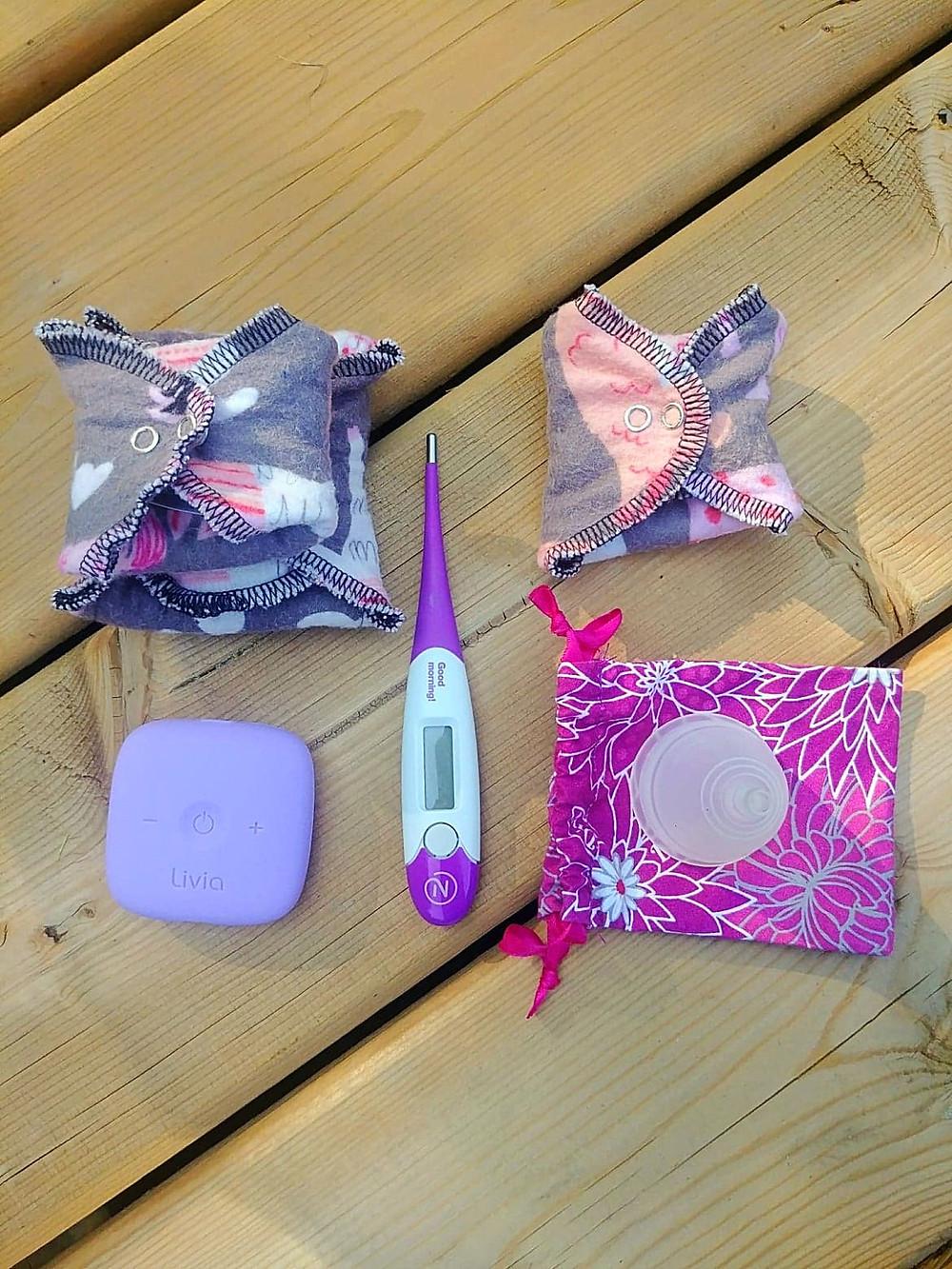 Female travel essentials including Livia, Natural Cycles birth control