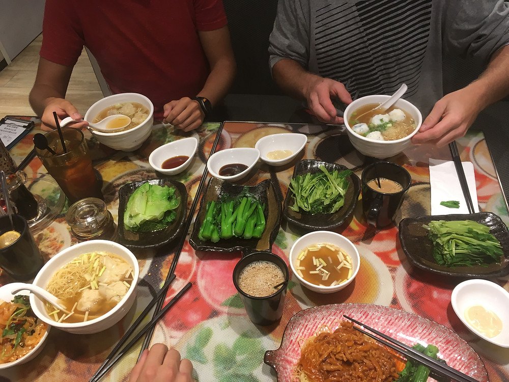 Huge table of food served in restaurant in Hong Kong