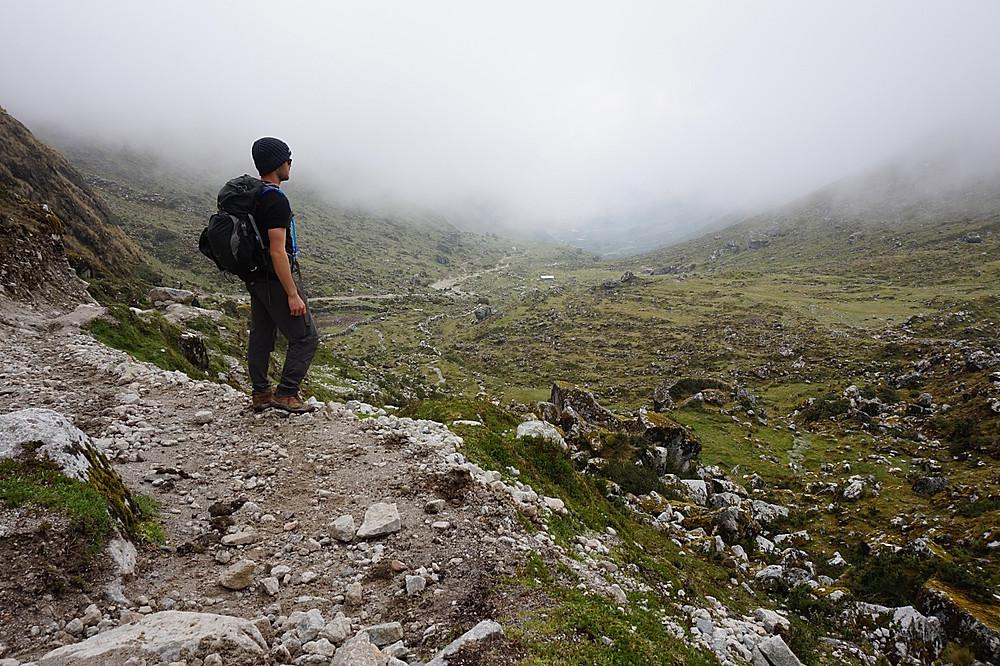 Hiker on the Salkantay Trek at the Salkantay Pass