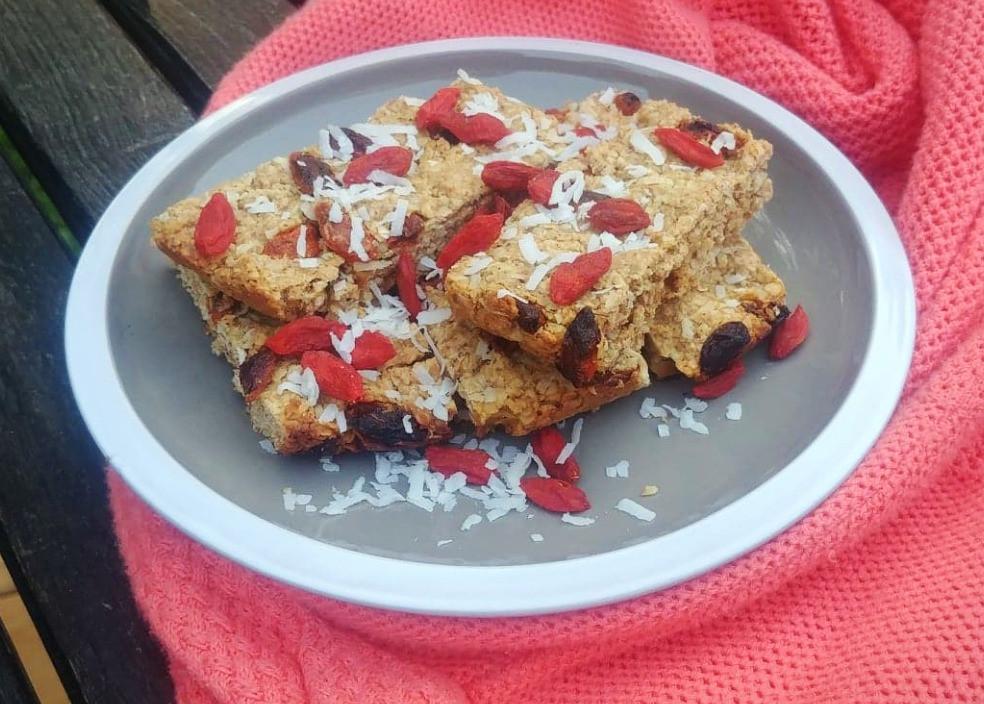 Freshly baked coconut granola bars with goji berries