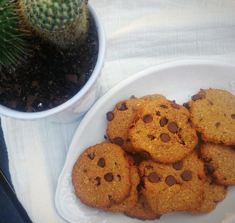 Chewy vegan chocolate chip cookies with cactus in background