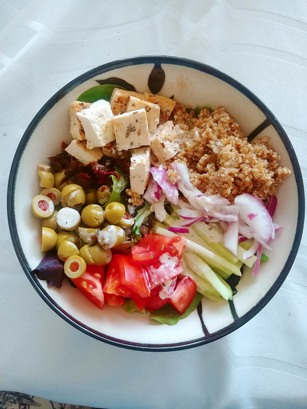 Greek bowl with quinoa and garlic tahini dressing