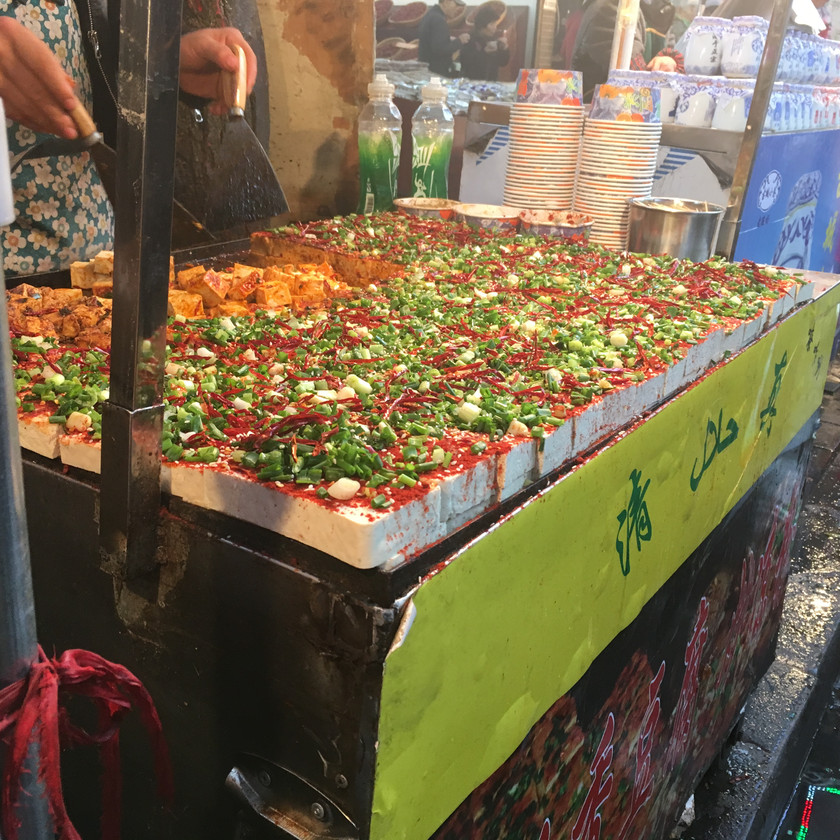 Cooked tofu with chili and green peppers at a street market in Xian