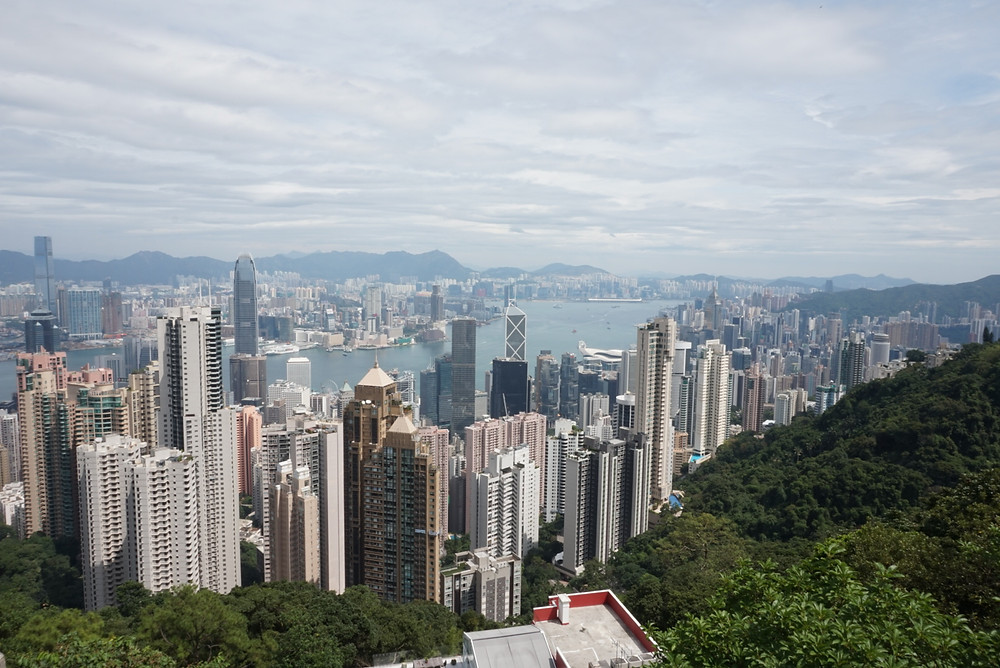 View of Hong Kong, Kowloon and Victoria Harbour from Victoria Peak with mountains in the background