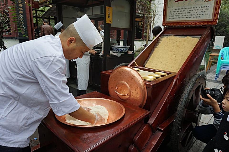 Chengdu chef preparing dumplings outside