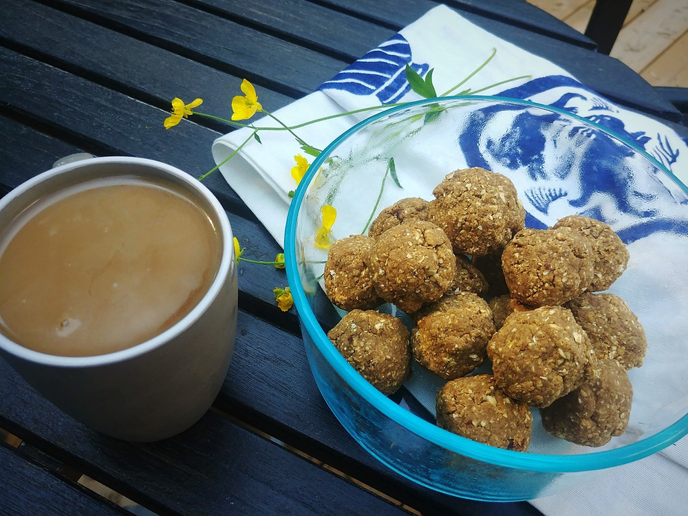 Vegan oatmeal raisin protein balls with a cup of coffee