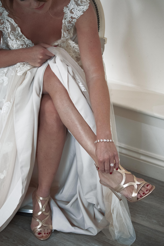 Bride Steps into Shoes