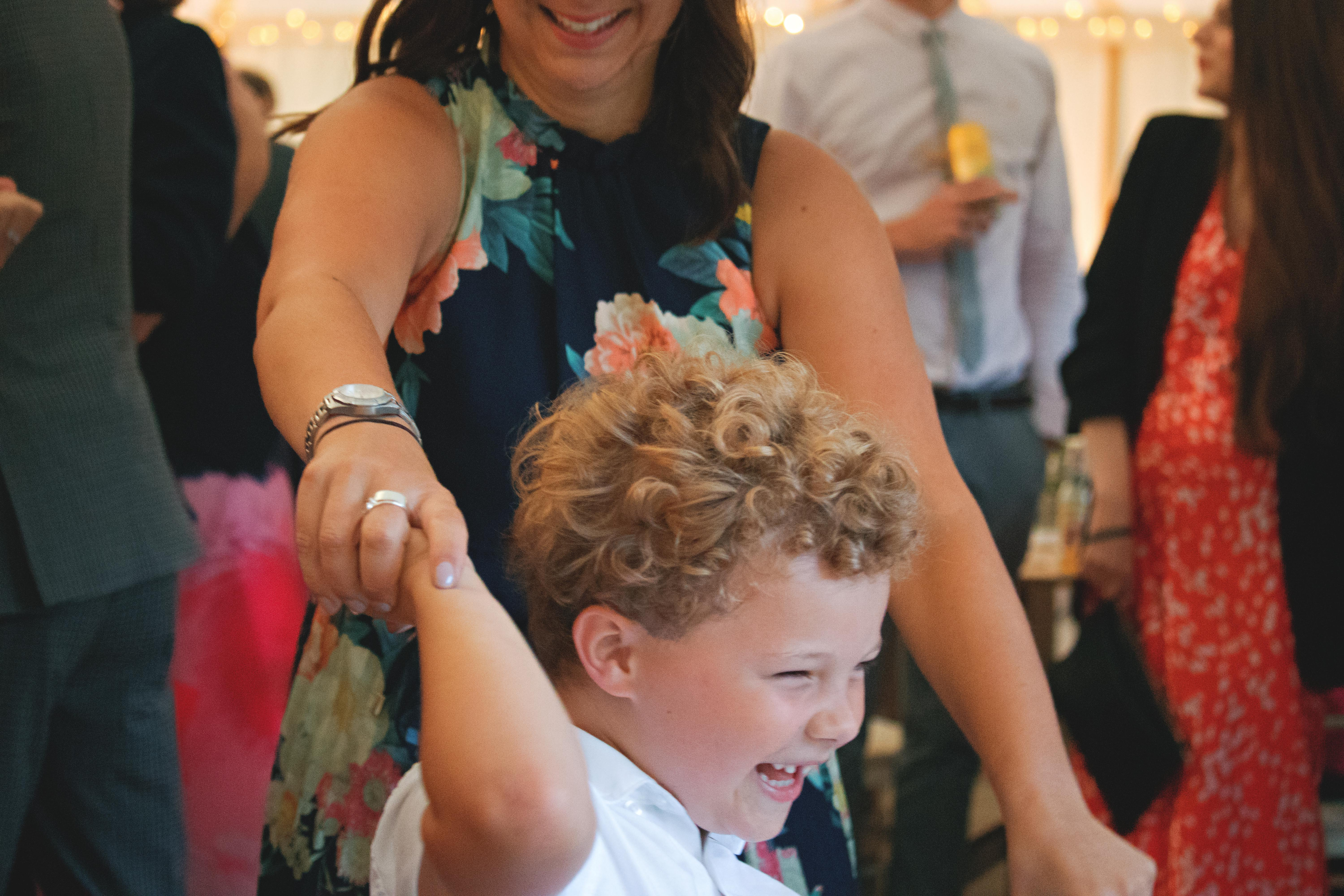 Relaxed Mother & Son Wedding Shot