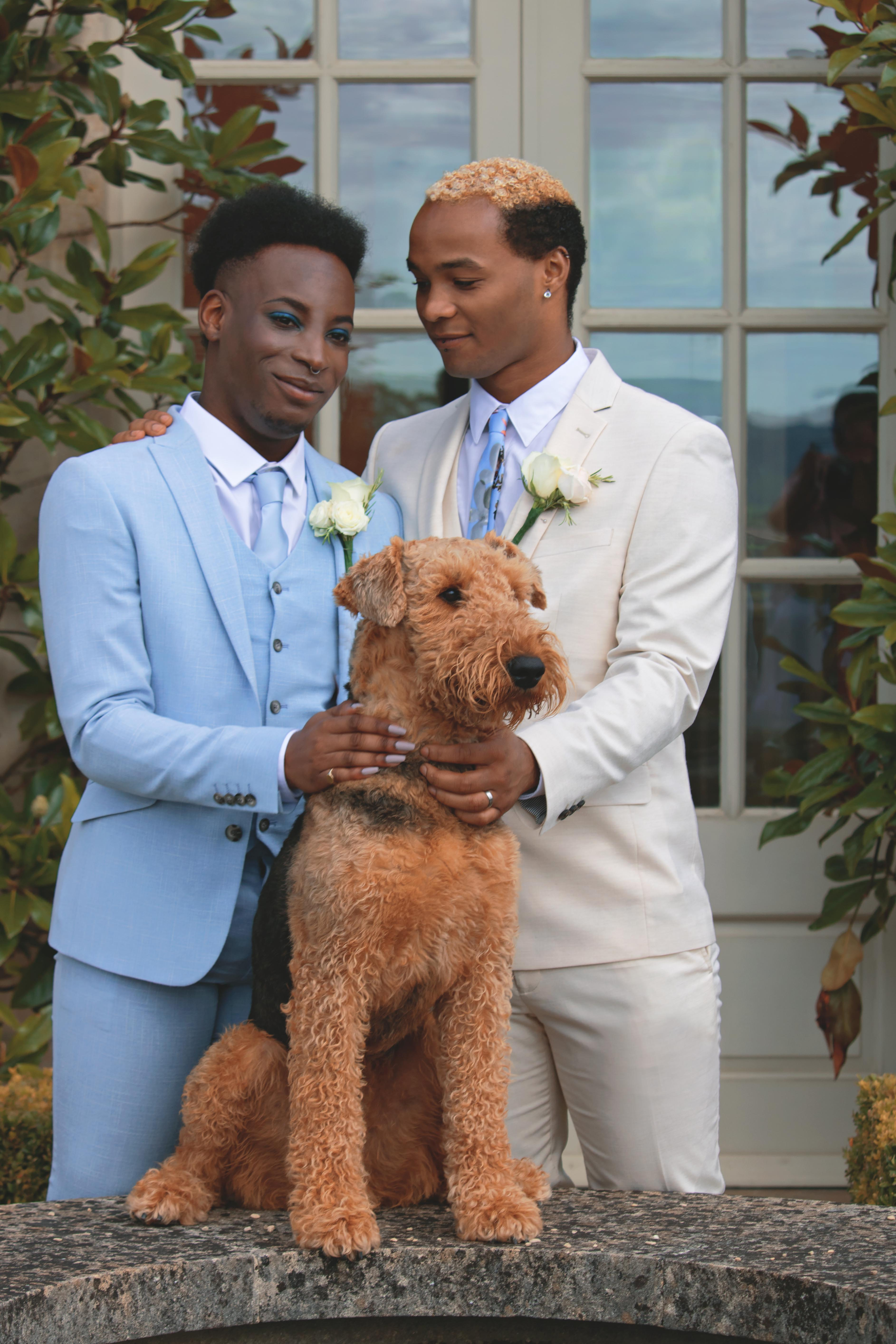 Grooms at their Pet at Beautiful Summer Tuscan Themed Wedding