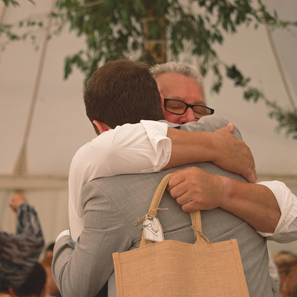 Groom & Father Candid Wedding Shot
