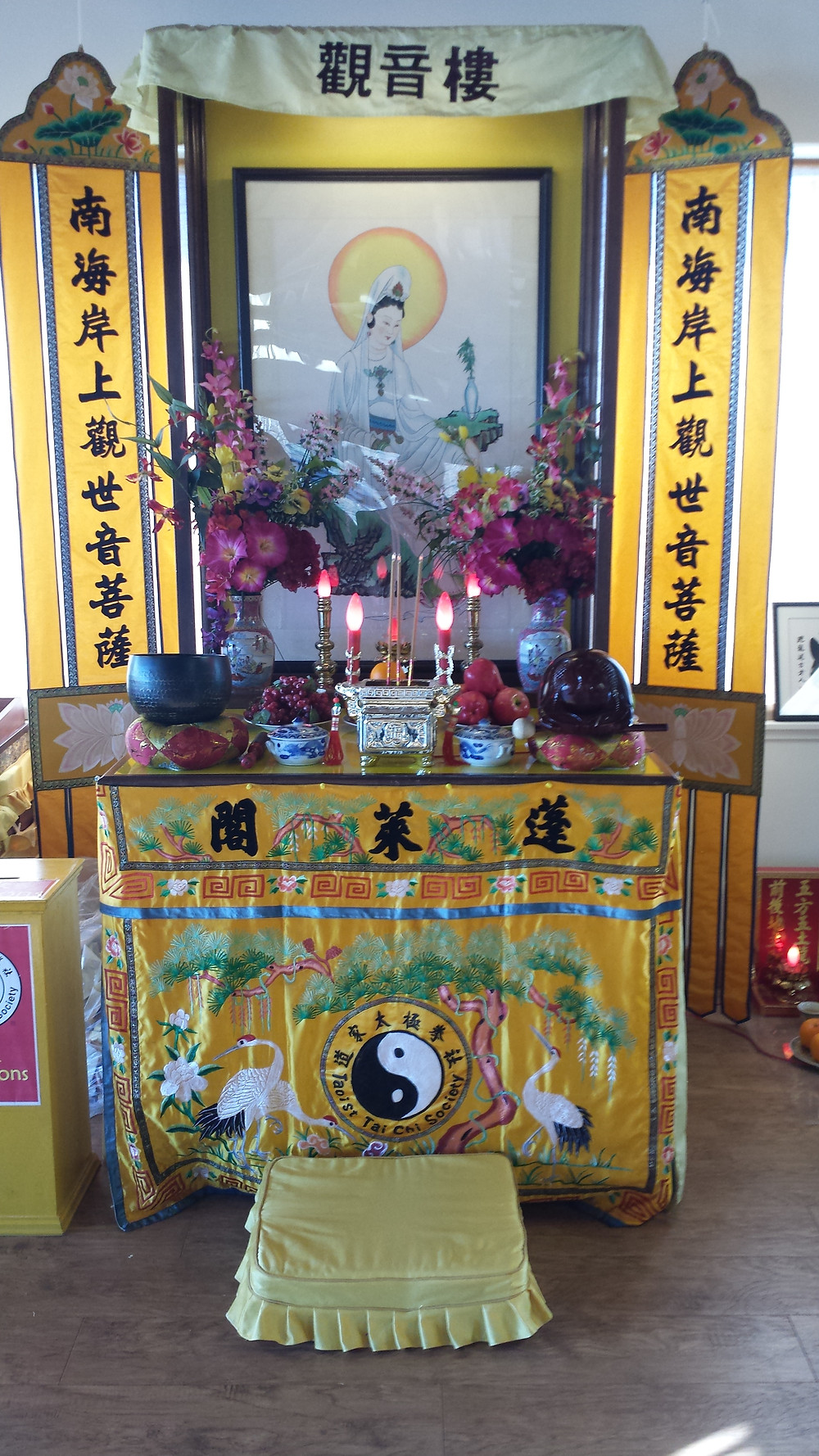 Daoist temple - figure is Quan Yin from Buddhism. China mingles its three religious traditions.