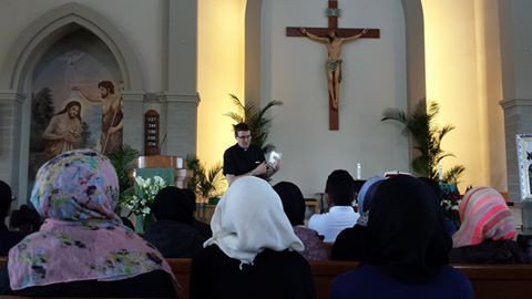 Visiting the Catholic church where the students had lots of questions about the trinity