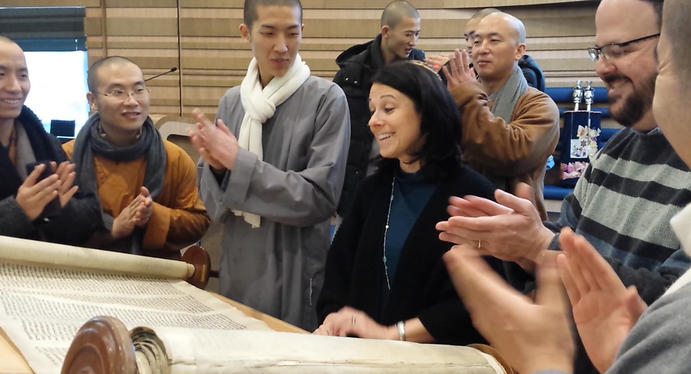 Buddhist monks appreciate a good chanter. This cantor left a good impression.
