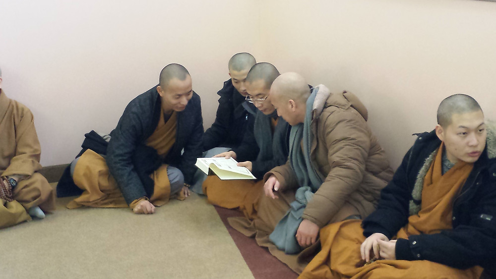 Looking at a Qur'an in Mandarin. They quite enjoyed that.