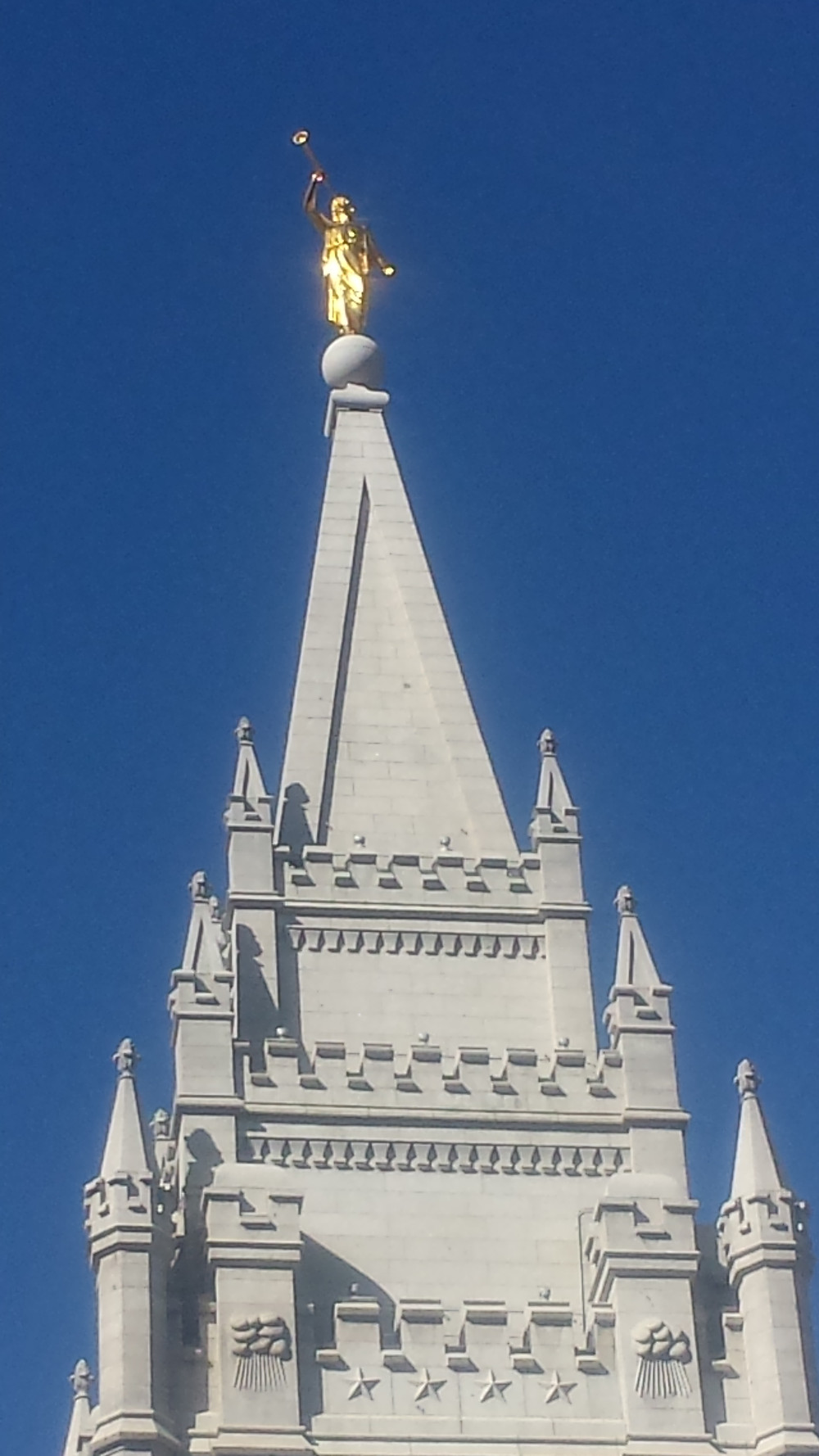 Atop every temple is the angel Moroni blowing his trumpet to herald in the last days.