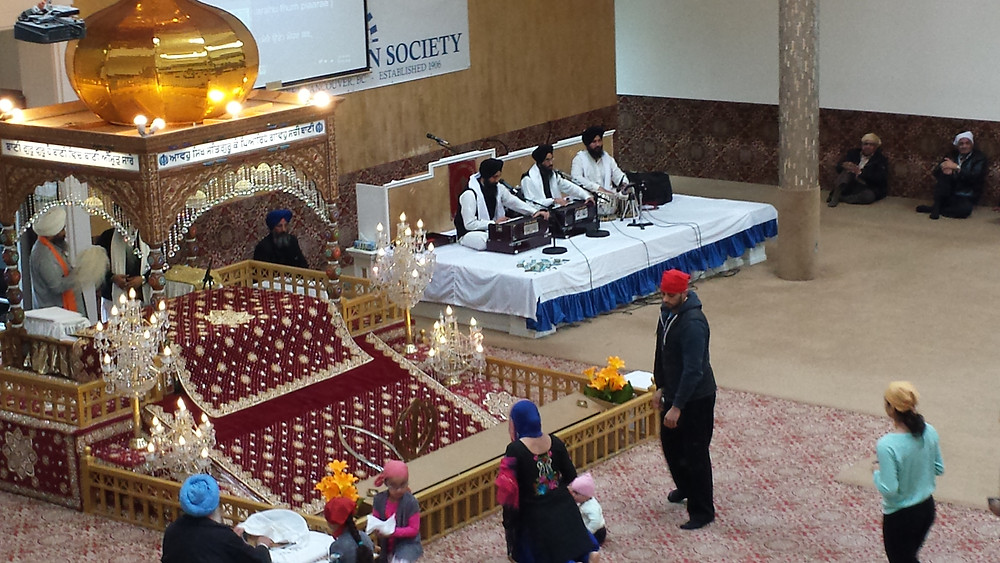 You can see here the main hall in the Sikh temple. The musicians played and sang the kirtan while adherents bowed in front of the throne which holds their sacred text.