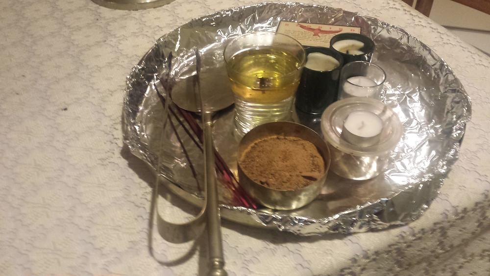 Items put into the Zoroastrian fire including myrrh (brown powder)