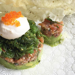 What about a delightful SMOKED SALMON TARTARE w edamame smash, wakami salad, sesame cracker and a po