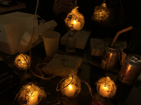 I created these moss ball lanterns for Jessie and the Elf Boy by placing battery powered tealights inside glass balls that I glued moss to. These were used to create a practical source of light in a way that didn't look out of place in a home belonging to a fairy.