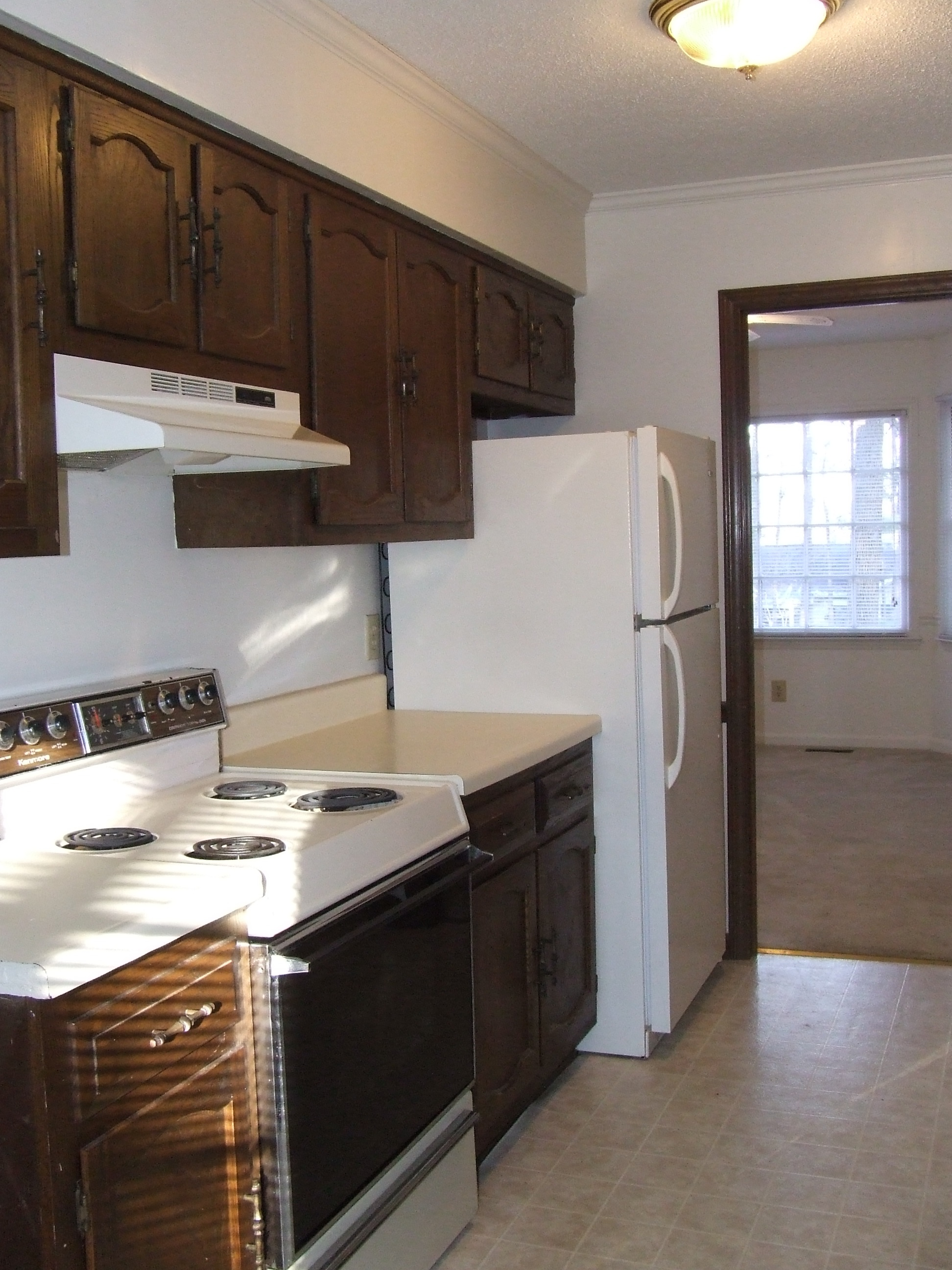 Nice Kitchen with plenty of Cabinets