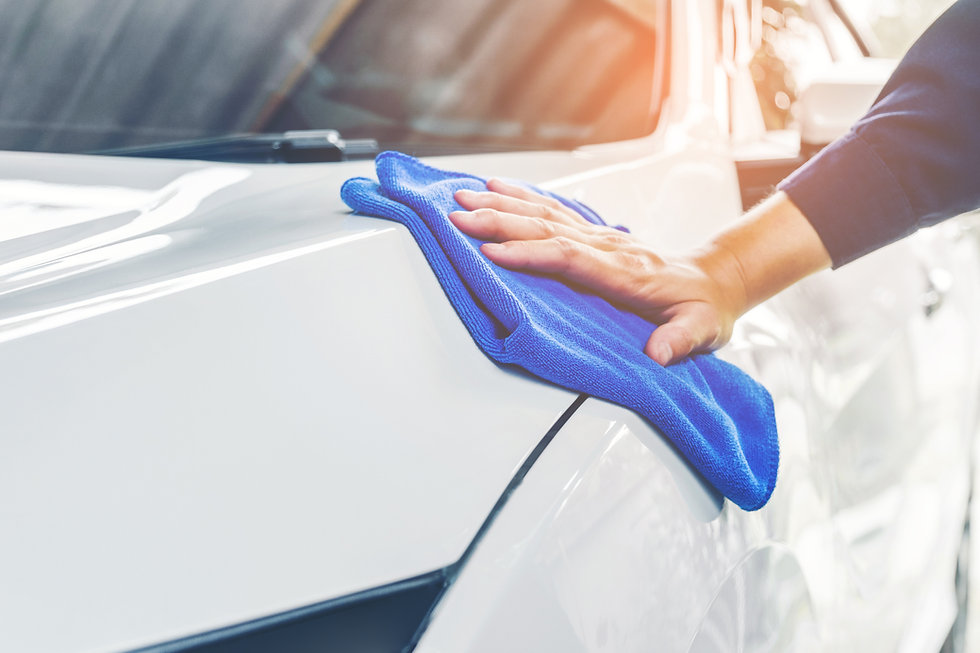 person-cleaning-a-car