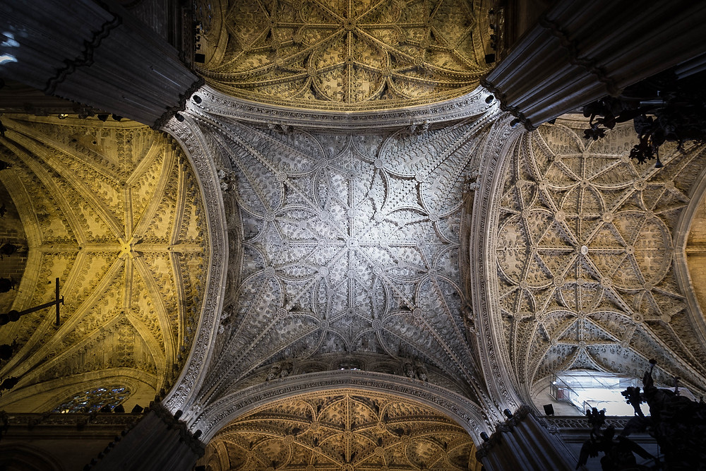Amazing view of the ceiling while laying down in a church pew