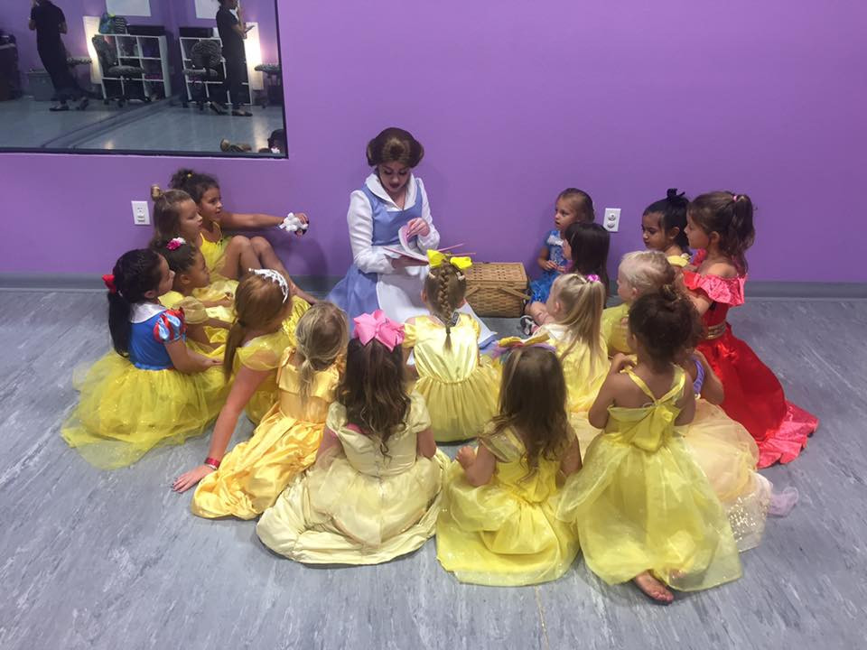 Belle reading with the campers