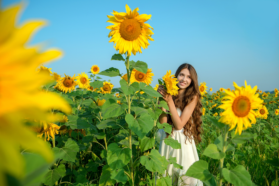 white_dress_girl_sunflowers.png
