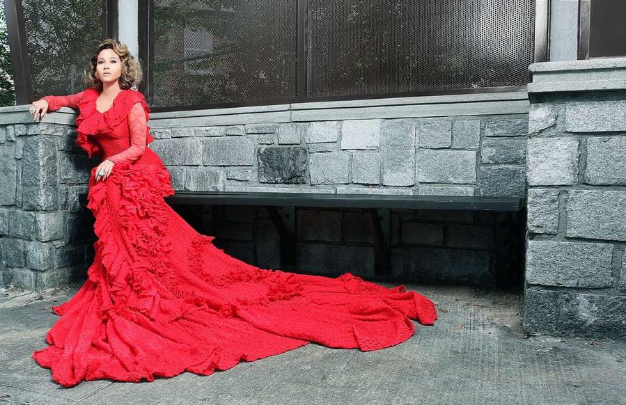 Adrienne Baillon Haughton wearing AVNAH gown