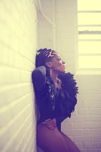 Dawn Richard wearing AVNAH Feather Top