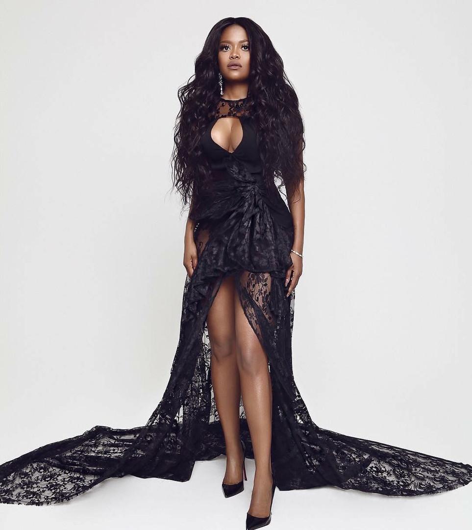 Karen Civil wearing AVNAH lace gown