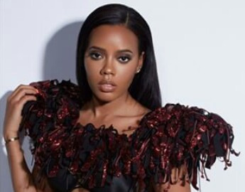 Angela Simmons wearing AVNAH Cage Top