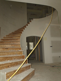 curved staircase drywall