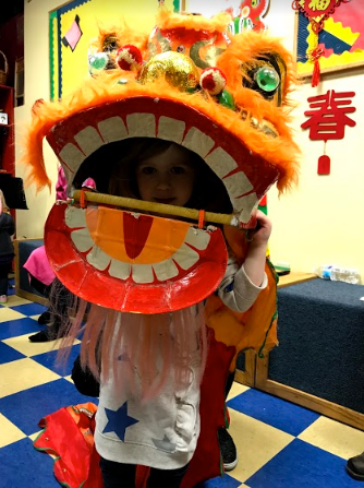 Youth Mandarin Class Student Wearing Traditional Lion Dance Head in School