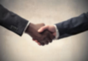 African businessman's hand shaking white