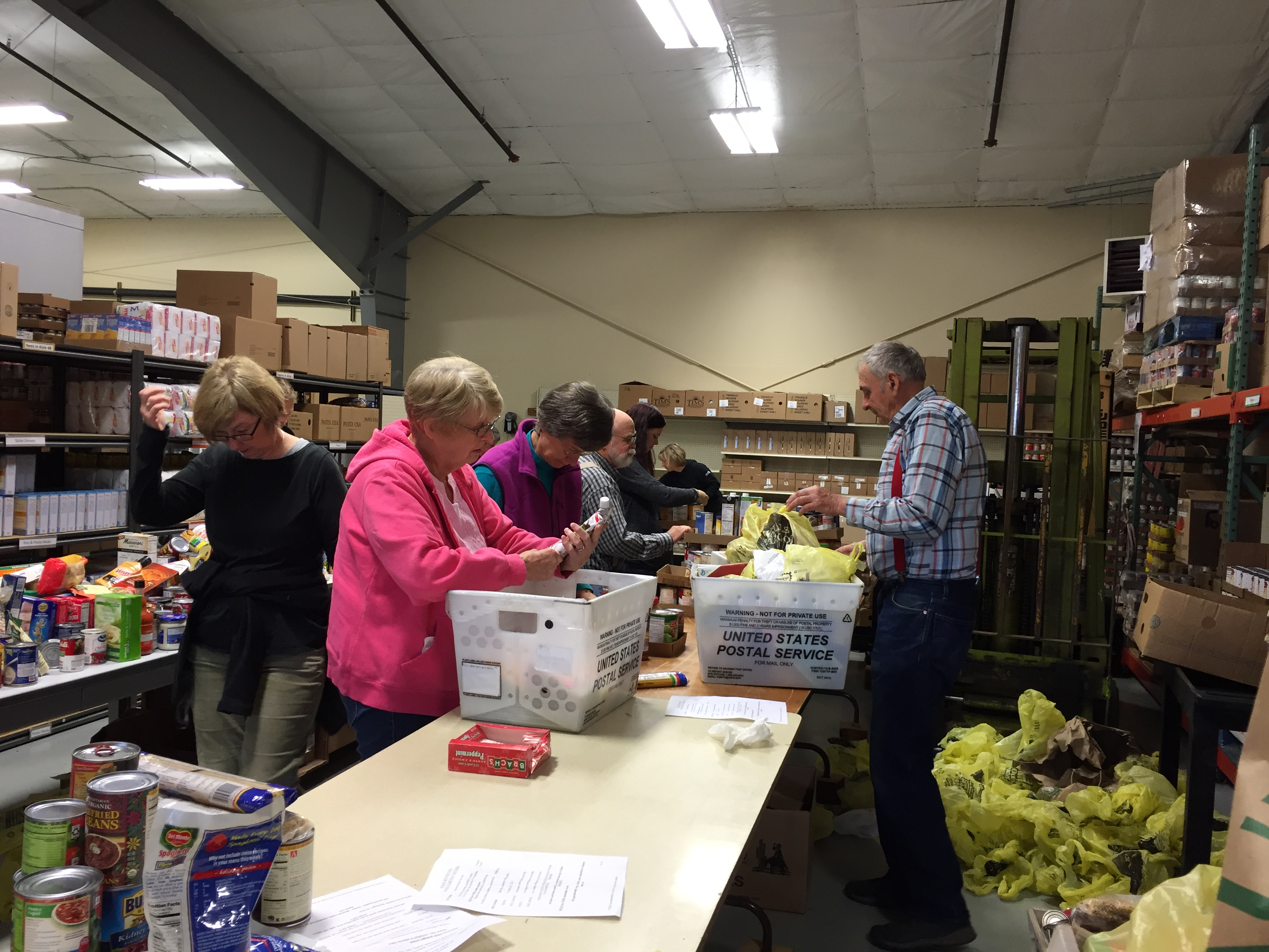 Volunteers sort food drive donations