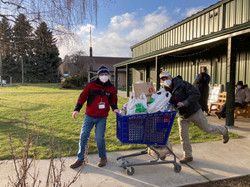 Rotary Club Volunteers Wheeling Out the Food