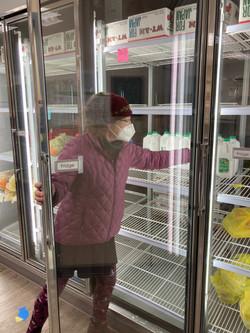 Ann L sets up for food distribution