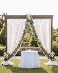 Wooden Elegant Arbor with Ivory Draping.