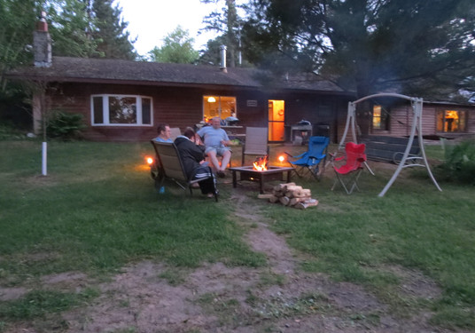 Grand Lodge around the fire.JPG
