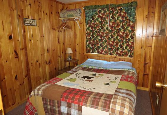 Walleye retreat cabin first bedroom/w Full bed.