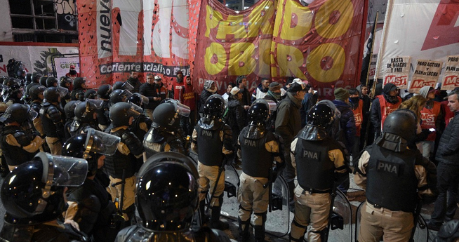 Riot Police stopping march