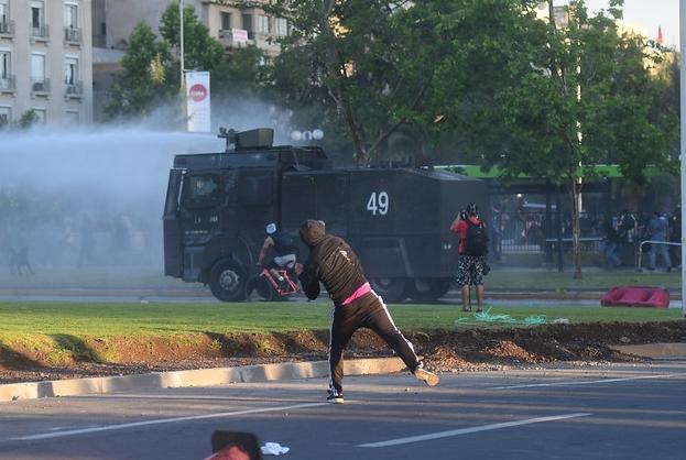 protestor throwing rocks