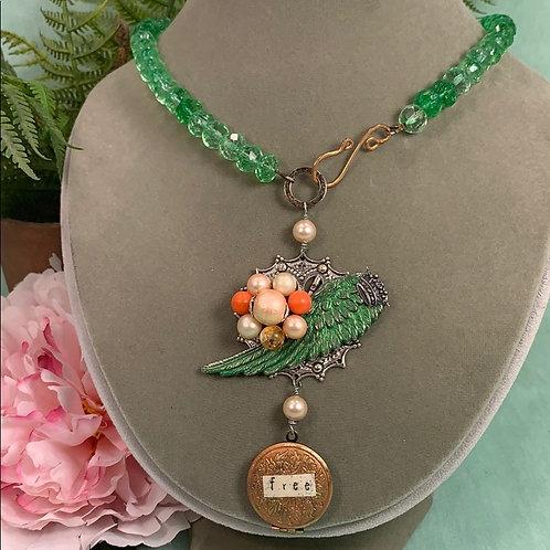 Green Born free locket wing crystal bead necklace
