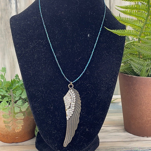 Adorned Crown minimalist feather necklace